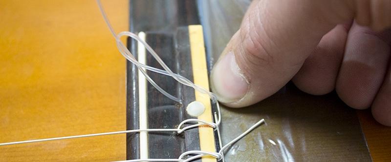 bien appuyer pour caler la corde classique nylon